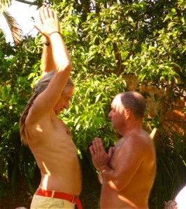 Yogi, Mark Whitwell gives hands on instruction to festival participant